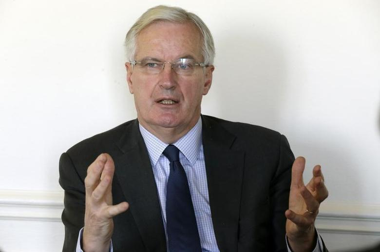 European Commissioner for Internal Market and Services Michel Barnier gestures as he speaks during an interview with Reuters at his office in Paris December 3, 2013. REUTERS/Jacky Naegelen
