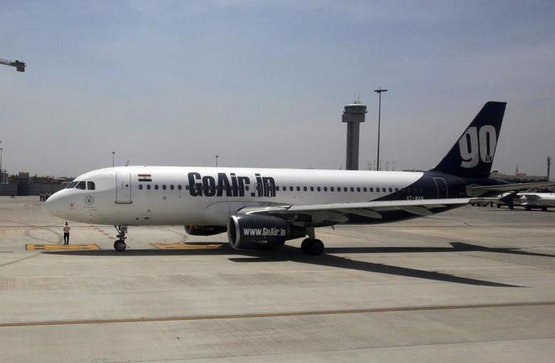 A GoAir aircraft taxis on the tarmac at Bengaluru International Airport in Bangalore March 9, 2012. REUTERS/Vivek Prakash