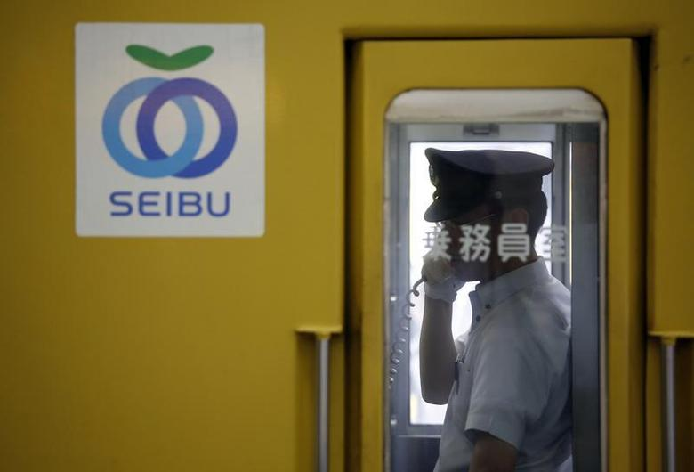 A crewman works inside a train coach of Seibu Railway Co., railway service unit of Seibu Holdings, at a station in Tokyo June 25, 2013. REUTERS/Issei Kato