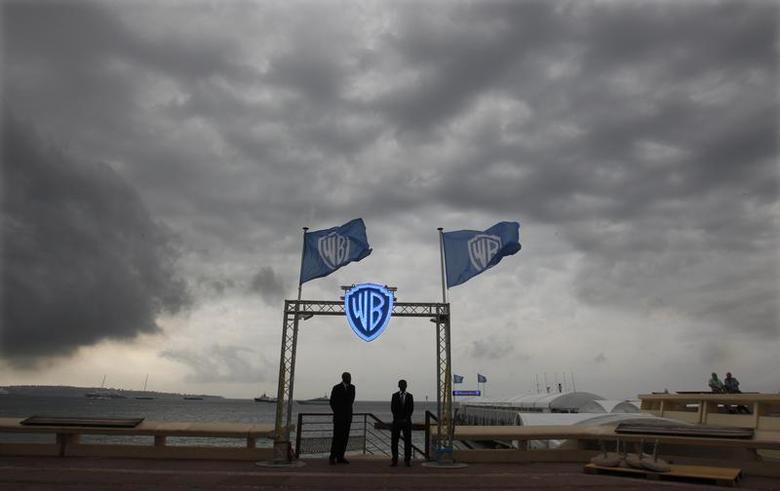 Security guards stand at the entrance of the Warner Bros beach during the annual MIPCOM television programme market in Cannes, southeastern France, October 4, 2010. REUTERS/Eric Gaillard