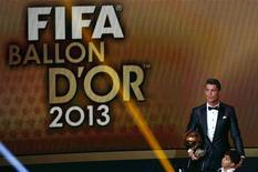 Portugal's Cristiano Ronaldo holds his trophy with his son Cristiano Ronaldo Jr after being awarded the FIFA Ballon d'Or 2013 in Zurich January 13, 2014. Portugal and Real Madrid forward Cristiano Ronaldo was named the world's best footballer for the second time on Monday, preventing his great rival Lionel Messi from winning the award for a fifth year in a row. REUTERS/Ruben Sprich