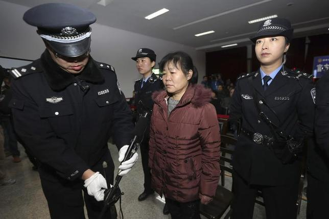 Zhang Shuxia, an obstetrician involved in baby trafficking, stands trial in Weinan Intermediate People's Court in Weinan, Shaanxi province, December 30, 2013. REUTERS/China Daily