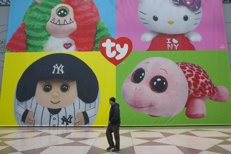 A man walks past a display for Ty Beanie Babies products at Toy Fair 2013 in New York, February 11, 2013. REUTERS/Andrew Kelly/Insider Images