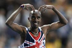 Mo Farah of Britain makes the 'Mobot' pose as he celebrates winning the men's 5,000 metres final during the IAAF World Athletics Championships at the Luzhniki stadium in Moscow August 16, 2013. REUTERS/Dylan Martinez