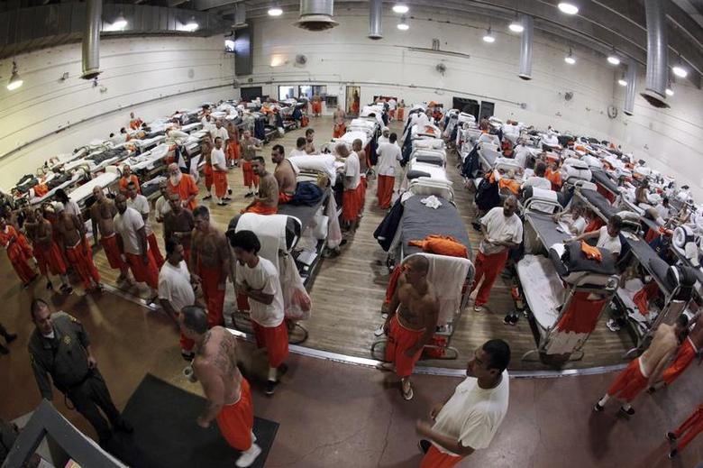 Inmates walk around a gymnasium where they are housed due to overcrowding at the California Institution for Men state prison in Chino, California, June 3, 2011. REUTERS/Lucy Nicholson