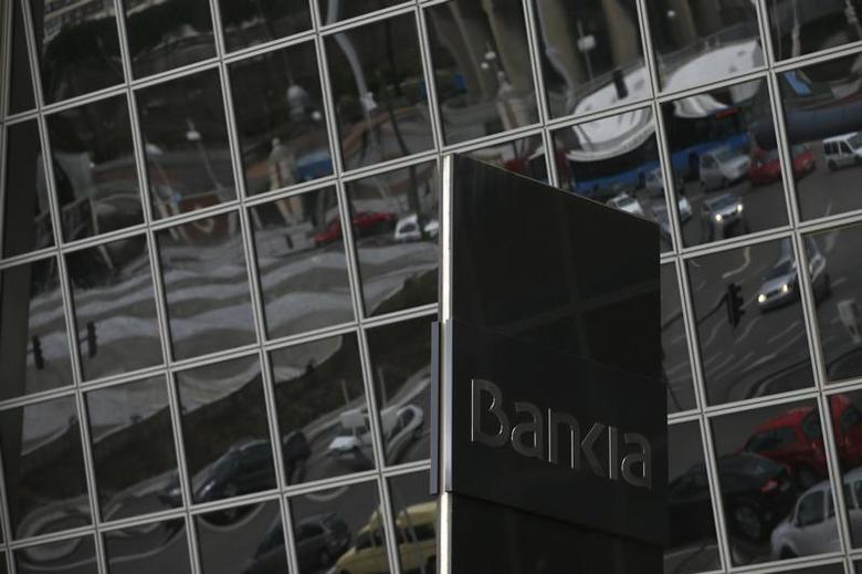 The logo for Spanish nationalized lender Bankia is pictured outside its headquarters in Madrid March 22, 2013. REUTERS/Juan Medina