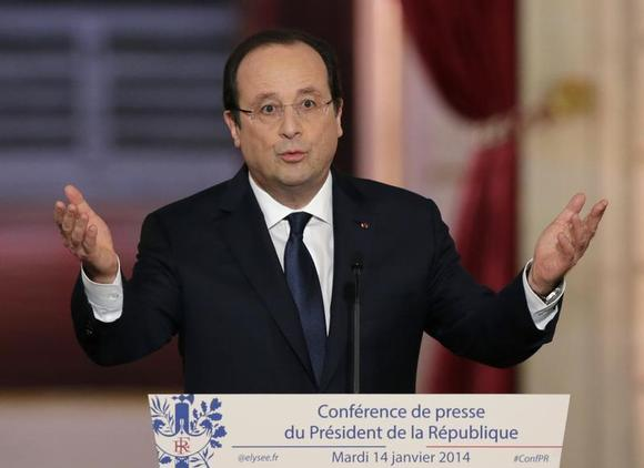 French President Francois Hollande addresses a news conference at the Elysee Palace in Paris, January 14, 2014. REUTERS/Philippe Wojazer