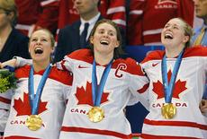 Canada's (L-R) Tessa Bonhomme, captain Hayley Wickenheiser and Haley Irwin celebrate their gold medal victory over the U.S. in their women's ice hockey game at the Vancouver 2010 Winter Olympics in this file photo from February 25, 2010. REUTERS/Todd Korol/Files