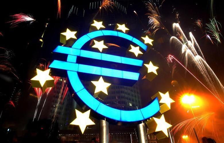Fireworks illuminate the sky around a huge euro sculpture, designed by German artist Ottmar Hoerl, in front of the headquarters of the European Central Bank (ECB) in Frankfurt, January 1, 2002. UNICS REUTERS/Kai Pfaffenbach