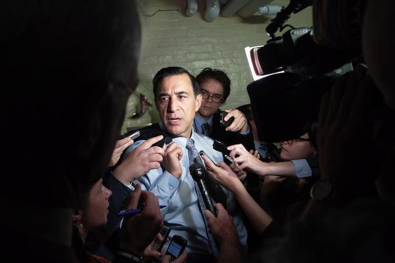 U.S. Representative Darrell Issa (R-CA) talks to reporters as he departs a House Republican caucus meeting at the U.S. Capitol in Washington, October 12, 2013. REUTERS/Jonathan Ernst