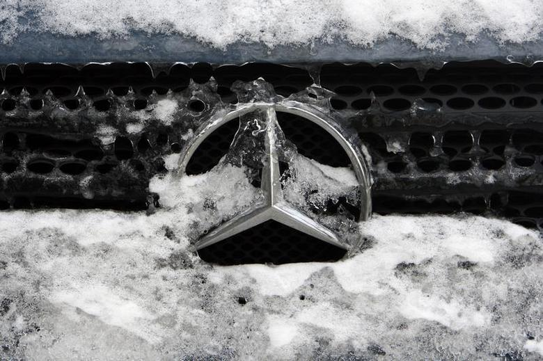 German car manufacturer Daimler's characteristic Mercedes-Benz star is seen covered with snow and ice on a vehicle in Bucharest February 10, 2012. REUTERS/Radu Sigheti