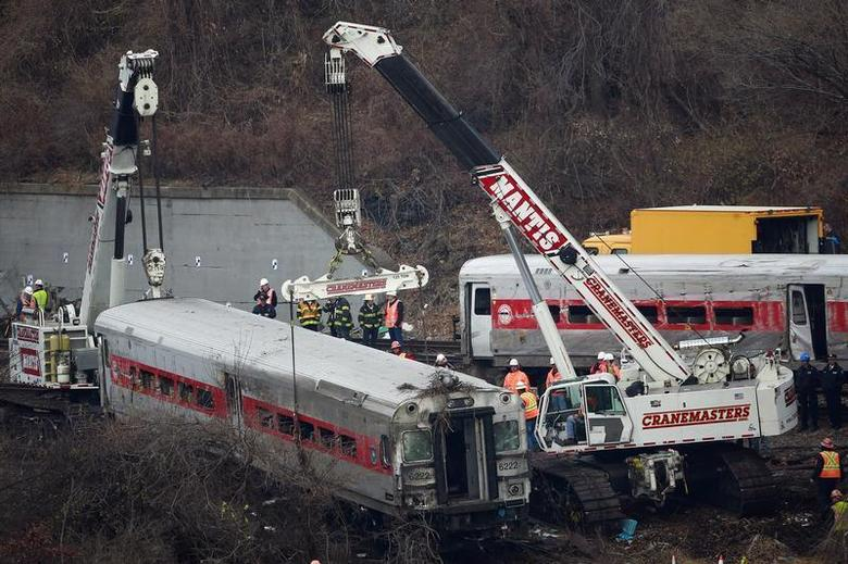 The lead car in the Metro-North train derailment is pulled from the marsh in the Bronx borough of New York December 2, 2013. REUTERS/Shannon Stapleton