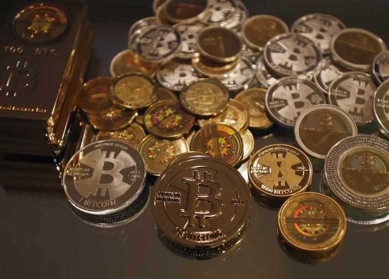 Some of Bitcoin enthusiast Mike Caldwell's coins are pictured at his office in Sandy, Utah, September 17, 2013.REUTERS/Jim Urquhart