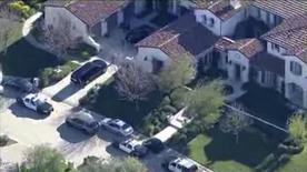 A still image captured from NBCLA.COM video footage shows an aerial view of police raid at teen pop star Justin Bieber's California home in Calabasas, California January 14, 2014. The police search of Bieber's California home on Tuesday in a vandalism case linked to the singer resulted in the arrest of a man after drugs were found in the house, the Los Angeles County Sheriff said. REUTERS/NBCLA.COM/Handout via Reuters