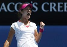 Li Na of China celebrates defeating Belinda Bencic of Switzerland in their women's singles match at the Australian Open 2014 tennis tournament in Melbourne January 15, 2014. REUTERS/Jason Reed