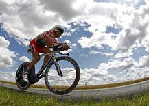 Team Europcar rider and best climber's polka dot jersey holder Thomas Voeckler of France cycles during the individual time trial of the 19th stage of the 99th Tour de France cycling race between Bonneval and Chartres, July 21, 2012. REUTERS/Bogdan Cristel