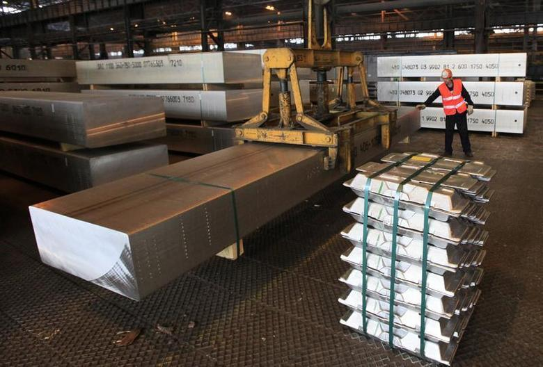 An employee moves a giant 7-ton aluminium ingot at the Rusal Sayanogorsk aluminium smelter outside the town of Sayanogorsk, some 480 km (298 miles) south of the Siberian city of Krasnoyarsk August 21, 2013. REUTERS/Ilya Naymushin