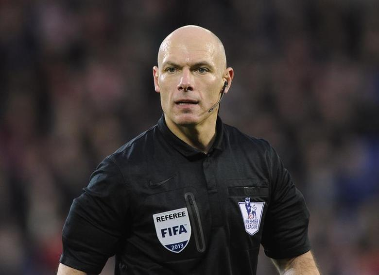 Referee Howard Webb looks on during the English Premier League soccer match between Cardiff City and West Bromwich Albion at Cardiff City Stadium in Cardiff, Wales, December 14, 2013. REUTERS/Rebecca Naden