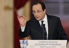 French President Francois Hollande answers a question during a news conference at the Elysee Palace in Paris, January 14, 2014. REUTERS/Philippe Wojazer