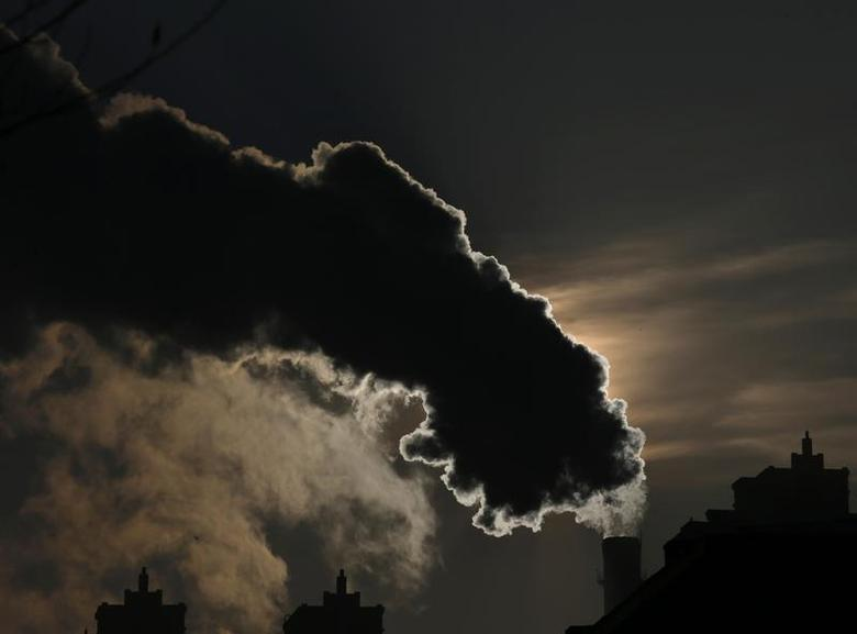 Smoke from a chimney is silhouetted against the rising sun in the northern city of Harbin, Heilongjiang province, January 6, 2014. REUTERS/Kim Kyung-Hoon