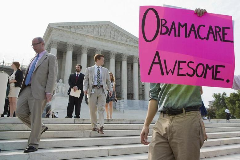 Supporters of the Affordable Healthcare Act gather in front of the Supreme Court before the court's announcement of the legality of the law in Washington on June 28, 2012. REUTERS/Joshua Roberts