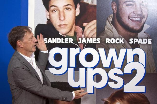 Director Dennis Dugan gestures to the poster in the backdrop as he arrives for the premiere of the film ''Grown Ups 2'' in New York, July 10, 2013. REUTERS/Lucas Jackson