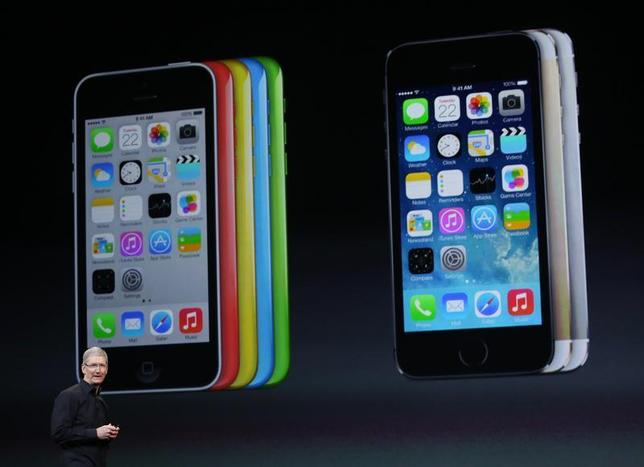 Apple Inc CEO Tim Cook speaks on stage during an Apple event in San Francisco, California October 22, 2013. REUTERS/Robert Galbraith/Files