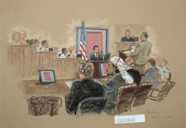 In this photograph of a sketch by courtroom artist Janet Hamlin, reviewed by the U.S. Military, defendant Salim Hamdan (front, 2nd L) looks at a video screen showing an exhibit as part of his trial inside the war crimes courthouse at Camp Justice, the legal complex of the U.S. Military Commissions, at Guantanamo Bay U.S. Naval Base in Cuba July 23, 2008. REUTERS/Janet Hamlin/Pool