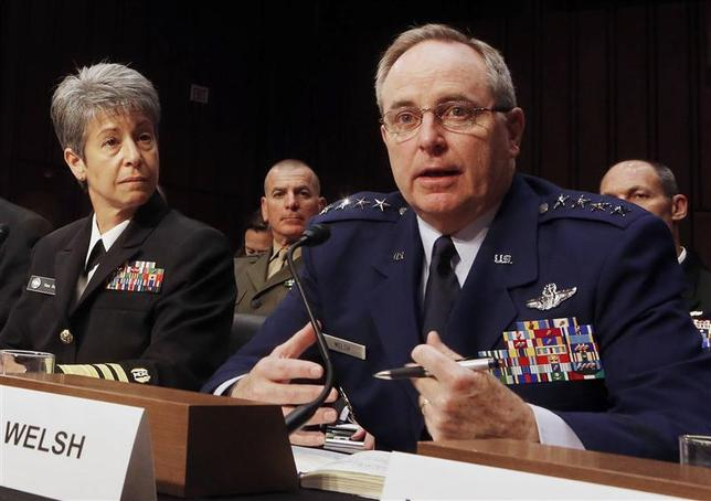 Air Force Chief of Staff Gen. Mark A. Welsh (R) testifies about pending legislation regarding sexual assaults in the military at a Senate Armed Services Committee on Capitol Hill in Washington in this file photo taken June 4, 2013. REUTERS/Larry Downing