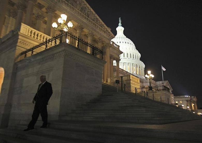 A member of the U.S. House of Representatives walks down the steps from the House Chamber as he exits the U.S. Capitol after the Republican-led House again voted to link funding for the U.S. government to include a delay of ''Obamacare'' in Washington, September 30, 2013. REUTERS/Jim Bourg