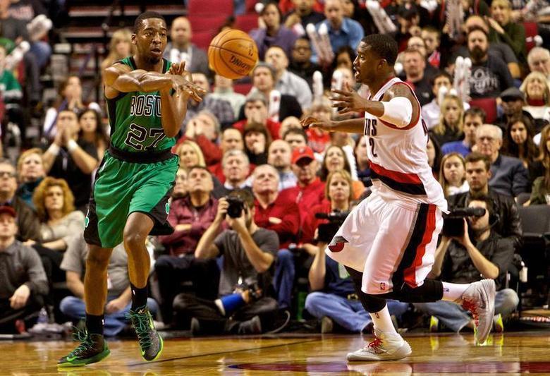 Boston Celtics shooting guard Jordan Crawford (27) passes away from Portland Trail Blazers shooting guard Wesley Matthews (2) at the Moda Center. Craig Mitchelldyer-USA TODAY Sports