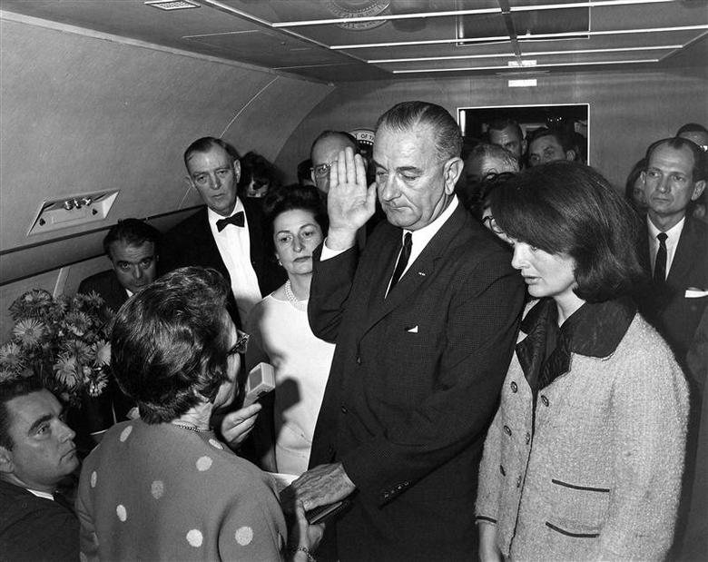Judge Sarah T. Hughes (L) administers the Presidential Oath of Office to then acting U.S. President Lyndon Baines Johnson (C) aboard Air Force One at Love Field in Dallas Texas, in this handout image taken on November 22, 1963. REUTERS/Cecil Stoughton/The White House/John F. Kennedy Presidential Library