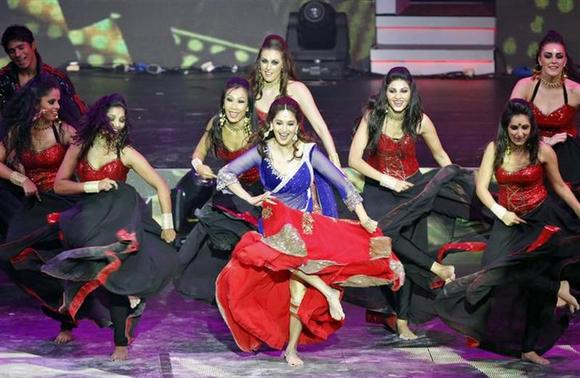 Bollywood actress Madhuri Dixit (C) performs at the 14th annual International Indian Film Academy (IIFA) awards show in Macau July 6, 2013. REUTERS/Tyrone Siu/Files