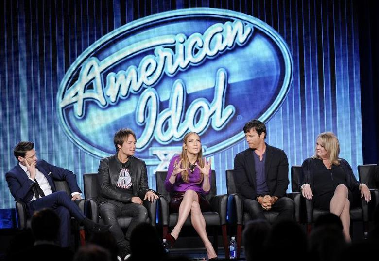 Host Ryan Seacrest (L-R), Judges Keith Urban, Jennifer Lopez, Harry Connick, Jr., and executive producer Trish Kinane of ''American Idol'' take part in Fox Broadcasting Company's part of the Television Critics Association (TCA) Winter 2014 presentations in Pasadena, California, January 13, 2014. REUTERS/Kevork Djansezian