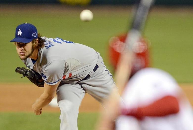 Oct 18, 2013; St. Louis, MO, USA; Los Angeles Dodgers starting pitcher Clayton Kershaw throws a pitch against the St. Louis Cardinals during the first inning in game six of the National League Championship Series baseball game at Busch Stadium. David E. Klutho/Pool Photo via USA TODAY Sports
