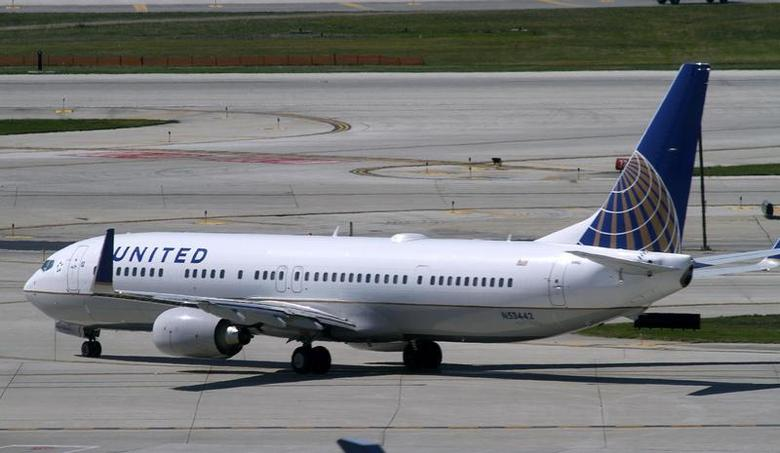 A United Airlines plane with the Continental Airlines logo on its tail, taxis to the runway at O'Hare International airport in Chicago October 1, 2010. REUTERS/Frank Polich