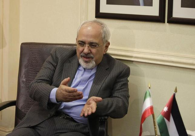 Iranian Foreign Minister Mohammad Javad Zarif meets with his Jordanian counterpart Nasser Judeh (not pictured) in Amman, Jordan January 14, 2014. REUTERS/Mohammad Hannon/Pool