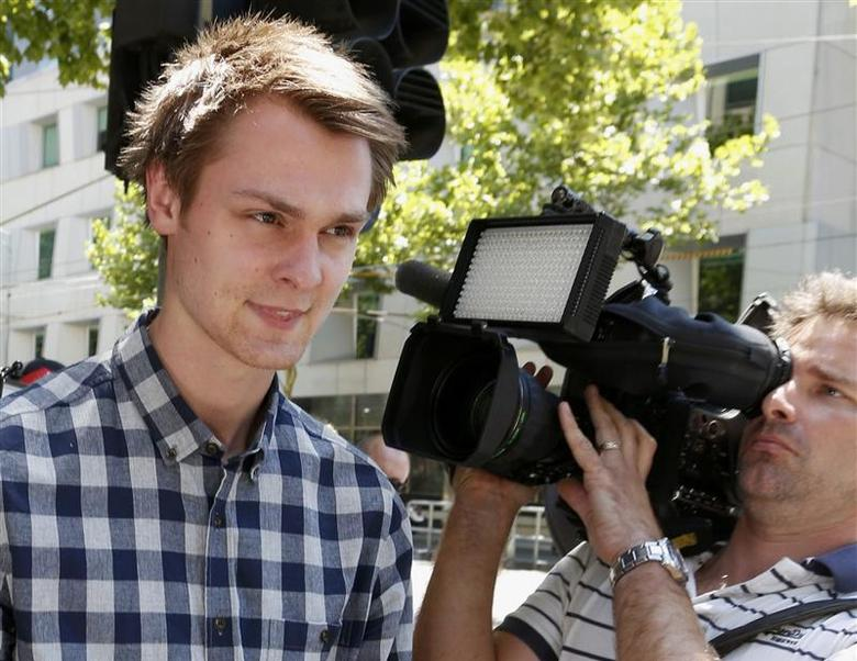 Daniel Dobson, a 22-year-old Briton arrested during an Australian Open 2014 tennis match at Melbourne Park on Tuesday, leaves Melbourne Magistrates' Court January 16, 2014. REUTERS/Brandon Malone