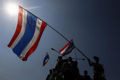 Thai graft body to probe rice subsidies, adding to PM's woes amid protests