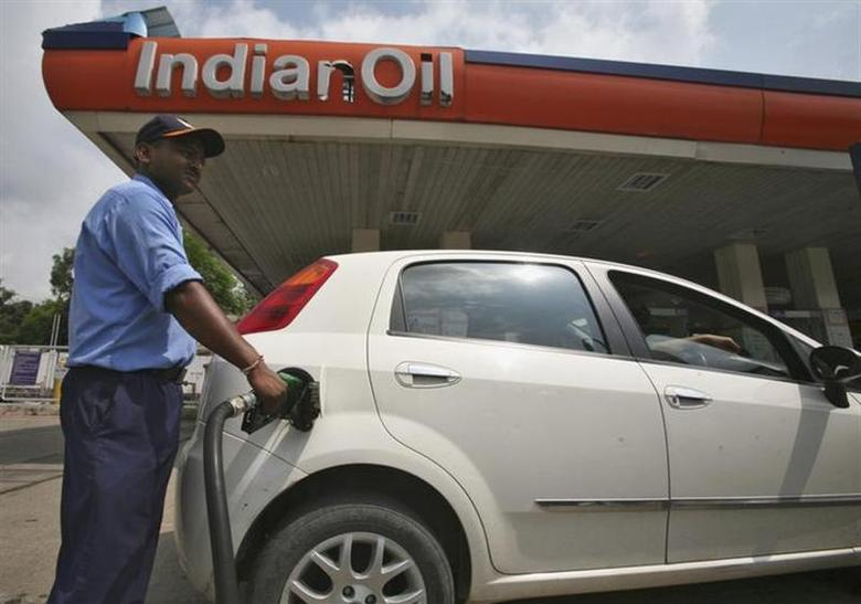 A worker fills a car with diesel at a fuel station in Jammu August 29, 2013. REUTERS/Mukesh Gupta/Files
