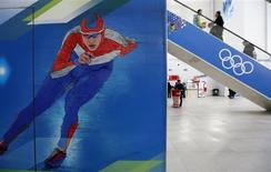 Visitors use an escalator in the Media Centre at the Olympic Park in Adler near Sochi January 16, 2014. REUTERS/Alexander Demianchuk