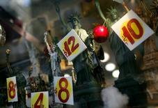 Prices are seen on replica Statues of Liberty figures in a shop window in New York City, November 14, 2011. REUTERS/Mike Segar
