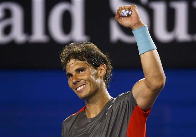 Rafael Nadal of Spain celebrates defeating Thanasi Kokkinakis of Australia in their men's singles match at the Australian Open 2014 tennis tournament in Melbourne January 16, 2014. REUTERS/David Gray