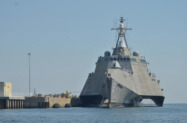 The littoral combat ship USS Independence (LCS 2) makes preparations at Naval Air Station Pensacola before getting underway in the Gulf of Mexico for a series of drills and training exercises in this September 12, 2011 handout photo courtesy of the U.S. Navy. REUTERS/U.S. Navy/Ensign Caleb White/Handout
