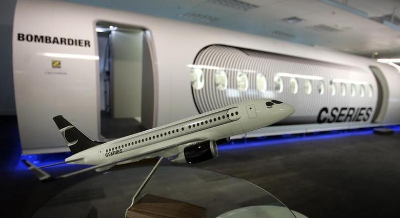 A scale model of a CS100 Bombardier airplane is displayed beside a mock-up of the future CSeries Bombardier aircraft at the Bombardier Inc. Montreal offices September 14, 2009. REUTERS/Christinne Muschi