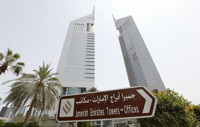 The Emirates Towers, which house the headquarters of Dubai Group, are seen on Sheikh Zayed road in Dubai May 9, 2013. REUTERS/Ahmed Jadallah