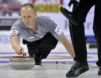 Skip Brad Jacobs throws a rock against Team Morris at the Roar of the Rings Canadian Olympic Curling Trials in Winnipeg, December 4, 2013. REUTERS/Fred Greenslade