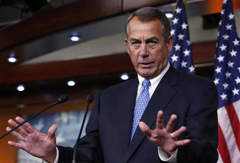 U.S. House Speaker John Boehner (R-OH) gestures as he speaks at a news conference on Capitol Hill in Washington January 16, 2014. REUTERS/Yuri Gripas