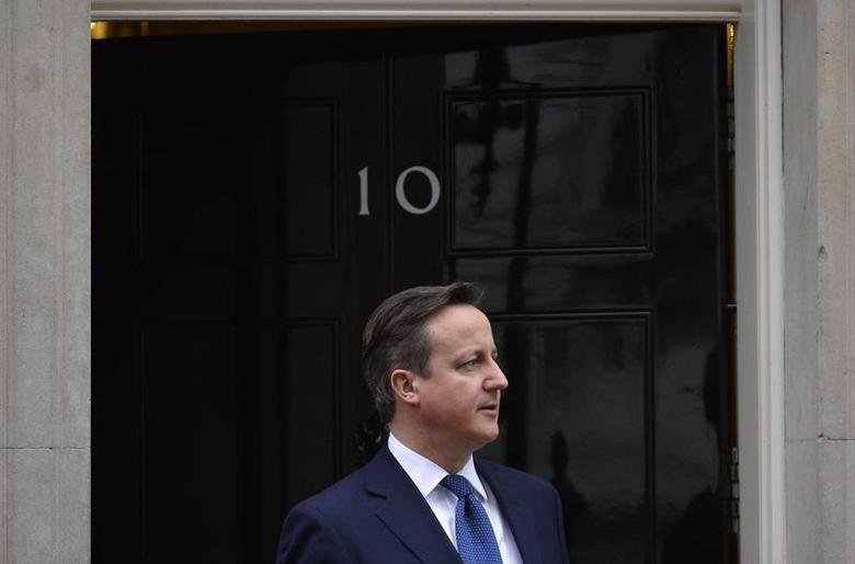 Britain's Prime Minister David Cameron waits to greet Cyprus's President Nicos Anastasiades at Cameron's official residence in Downing Street in central London January 15, 2014. REUTERS/Toby Melville