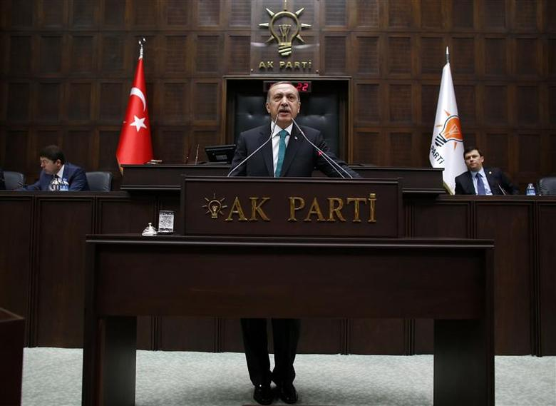 Turkey's Prime Minister Tayyip Erdogan addresses members of parliament from his ruling AK Party (AKP) during a meeting at the parliament in Ankara January 14, 2014. REUTERS/Umit Bektas
